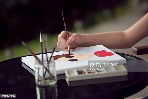 Child painting a portrait