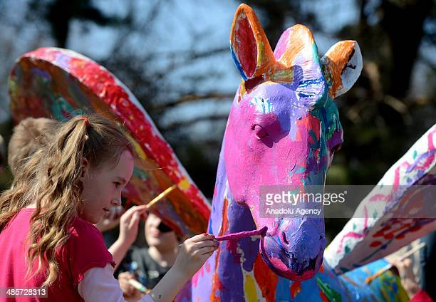 A child paints as Russians picnic at the Tsvetnoy Ticino park in Moscow the day after traditional foods blessed for Easter temperature hits 20 degree...