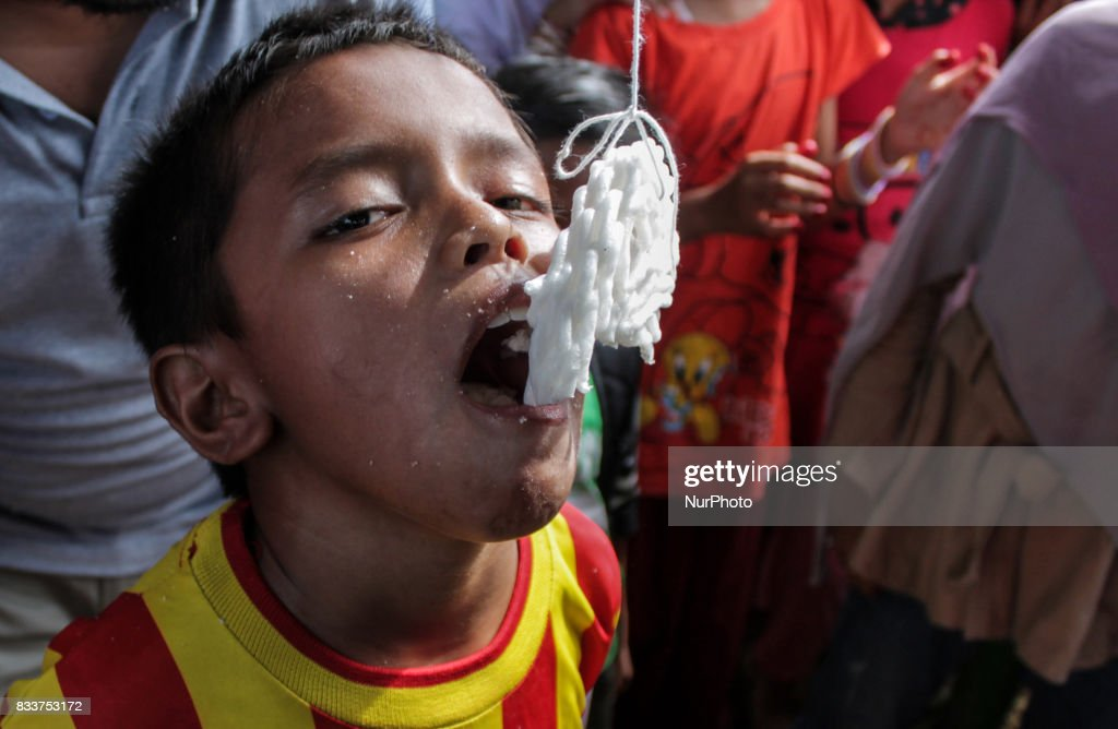 A child participated in a snack competition during the 72th Indonesia Independence Day celebration, in Lhokseumawe on 17 August 2017, in Aceh Province, Indonesia. People participate in traditional games every year to celebrate Indonesia's Independence Day commemorated every August 17th.