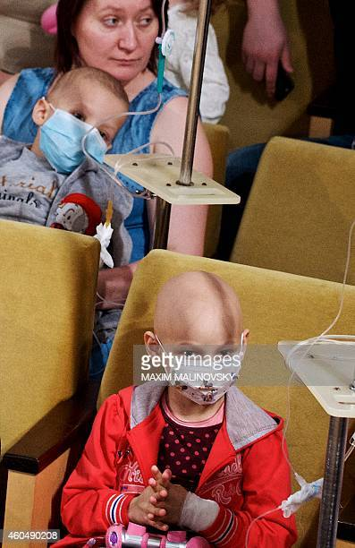 Child patients and their parents watch a New Year performance at the children's hematological and oncological centre in Minsk on December 15 2014 AFP...