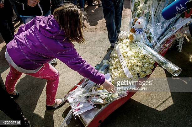 A child places flowers as thousands of people pay their respect on April 18 2015 to nineyearoldgirl Chloe who was raped and killed by a 38yearold...