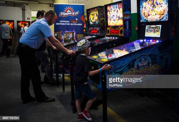 Child play on flipper machine on Pixel Heaven fair in Warsaw 26 May Poland