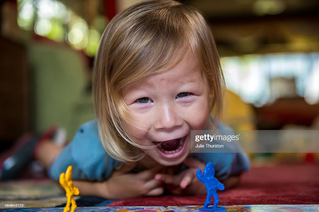 Child Playing and Having Fun With a Board Game : Stock Photo