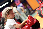 Child playing arcade simulator machine at an amusement park