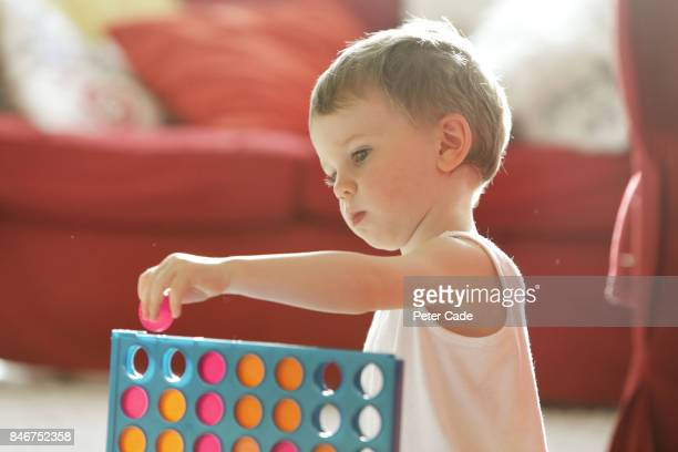 Child playing game in house