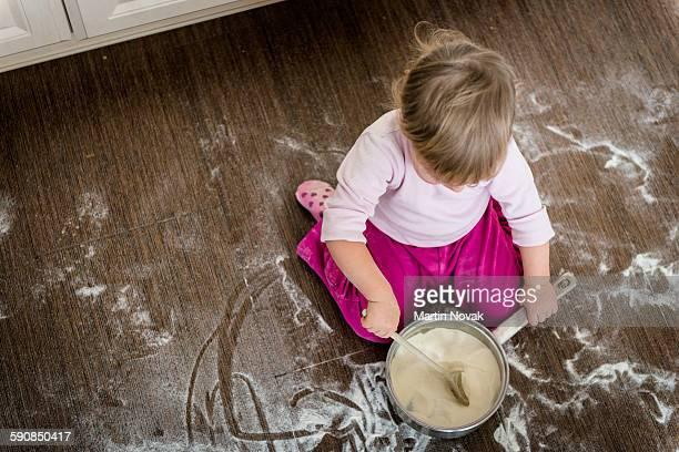 Child playing in kitchen floor
