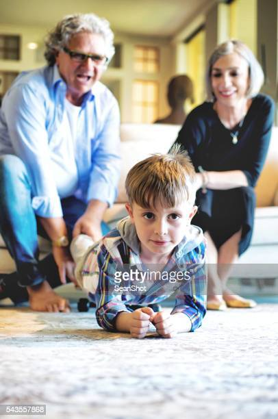 Child Playing in Livingroom with his Grandparents