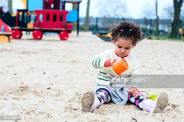 Child playing in sand pit