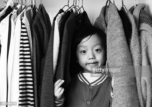 Child playing in the closet
