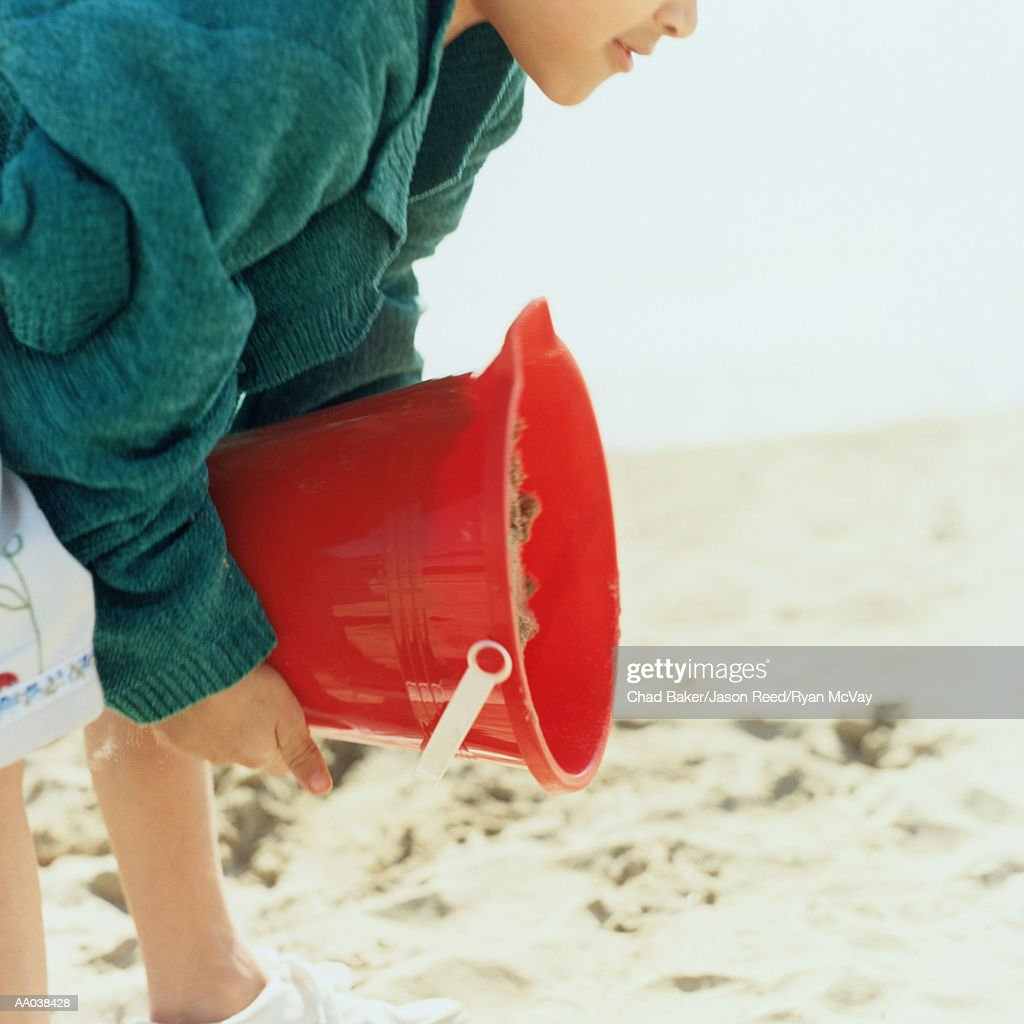 Child Playing in the Sand : Stock Photo