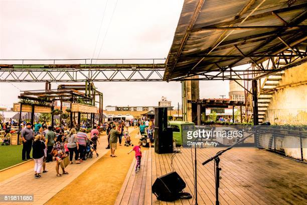 WACO, TX, USA  MARCH 18, 2017: Child playing on live entertainment stage at Magnolia Silos.