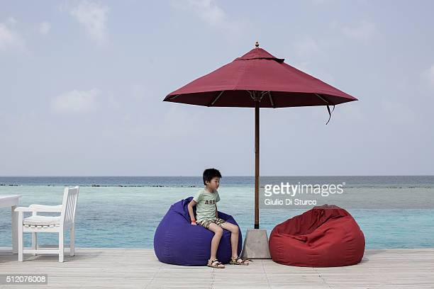 A child playing on the beanbag chairs by the jetty bar on January 27 2016 at Centara Ras fushi Resort and Spa Maldives China's top diplomats...