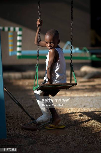 Child playing on the playground of the Comprehensive Community Based Rehabilitation in Tanzania CCBRT organization's hospital
