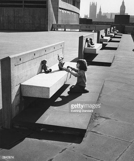 A child playing outside the Hayward Gallery on London's South Bank