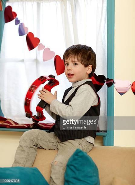 Child, playing, tambourine, sitting, window