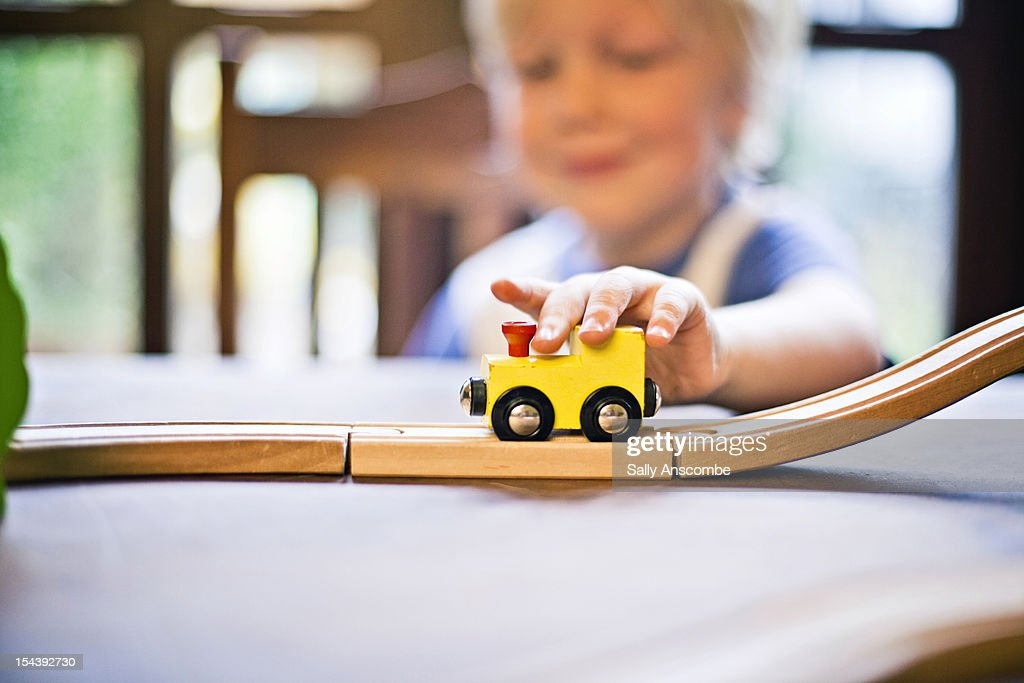 Child playing with a toy train