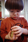Child playing with chocolate coins