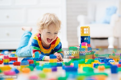 Child playing with toy blocks. Toys for kids. : Stock Photo