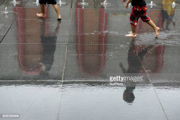 A child plays at a fountain in front an art work created by Chinese Ai Weiwei a Chinese contemporary artist and activist is on display during...
