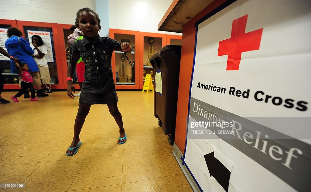 A child plays at an evacuation shelter in Kentwood, northeast of New Orleans on August 30, 2012 in Louisiana, where Tropical Storm Isaac has dumped more rain onto an already saturated Gulf Coast leaving residents to seek safety from flooding. Authorities in two states along the US Gulf Coast urged residents to seek shelter amid fears the Percy Quin dam in Mississippi near the Louisiana border showed signs of damage due to the storm. AFP PHOTO / Frederic J. BROWN