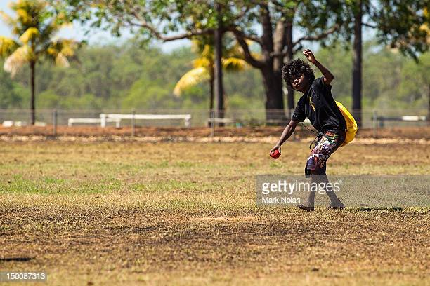 A child plays cricket during a visit by the Australian cricket team to Pirlangimpi of the Tiwi Islands on August 10 2012 on the Tiwi Islands Australia