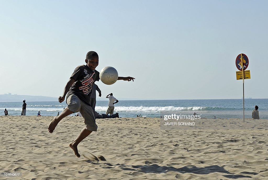A child plays football on a beach in Durban on June 5, 2010. Durban will be one of the nine cities hosting matches of the 2010 World Cup held in South Africa from June 11 to July 11.