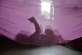 A child plays in a cloth hammock hung inside a room at the Salgoi Tea Estate on the outskirts of the Karimganj district in northeastern Assam state...