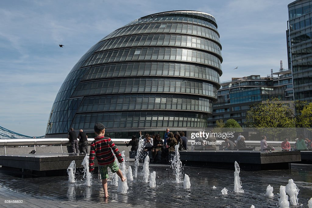 A child plays in fountains near City Hall, the headquaters of the Mayor of London and the London Assembly on the southbank of the River Thames as Londoners vote for a new Mayor on May 5, 2016 in London, United Kingdom. Today,dubbed 'Super Thursday',sees the British public vote in countrywide elections to choose members for the Scottish Parliament, the Welsh Assembly, the Northern Ireland Assembly, Local Councils, a new London Mayor and Police and Crime Commissioners. There are around 45 million registered voters in the UK and polling stations open from 7am until 10pm.
