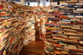 A child plays in the 'aMAZEme' labyrinth made from books at The Southbank Centre on July 31 2012 in London England Brazilian artists Marcos Saboya...