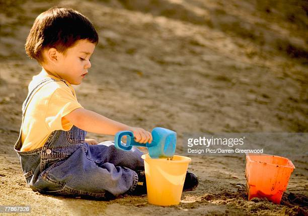 Child plays in the sand
