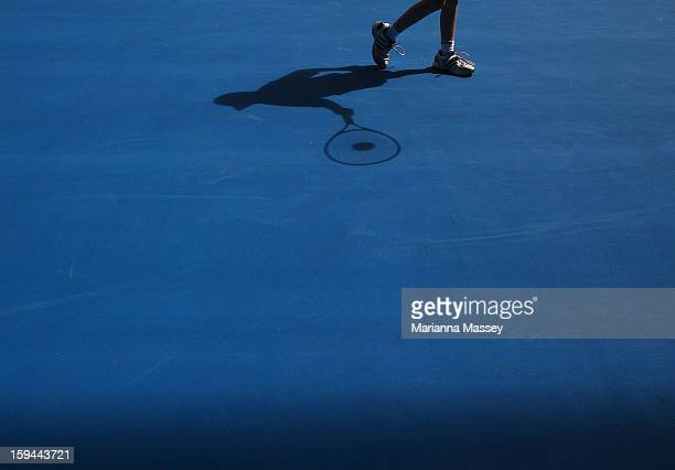 A child plays on center court during the HotShots mini tennis during day one of the 2013 Australian Open at Melbourne Park on January 14 2013 in...