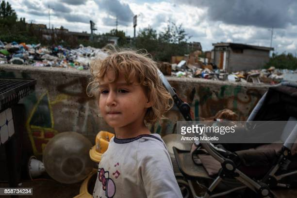 A child plays outside an occupied building on October 4 2017 in Rome ItalyFor the last 5 years hundreds of people including Italians Roma and...
