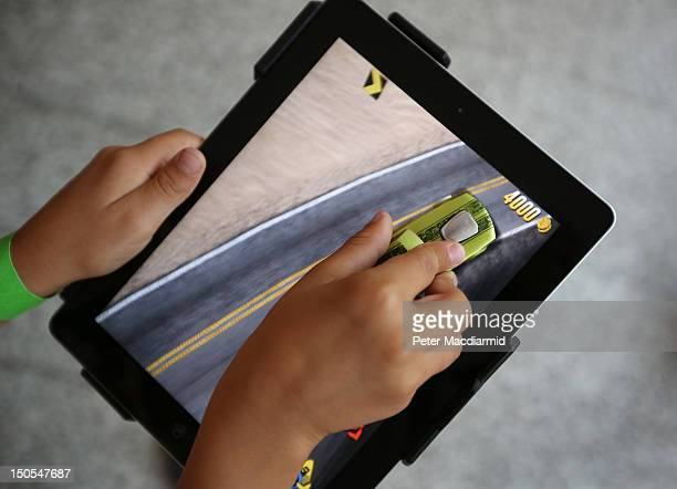 A child plays with an iPad and the apptivity app at Westfield shopping Centre on August 21 2012 in London England The new app from toy maker Mattel...
