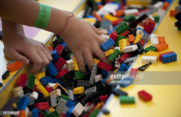 A child plays with LEGO building blocks while visiting the National Building Museum's exhibit 'Lego Architecture Towering Ambition' in Washington DC...