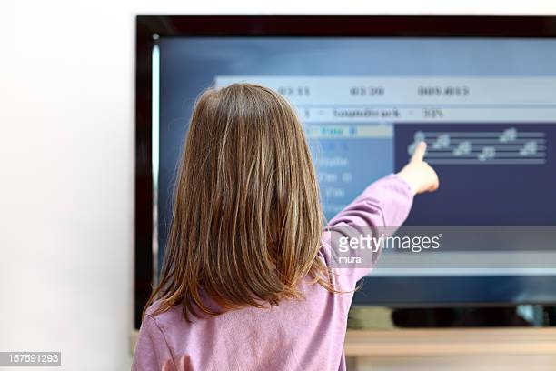 Child pointing at interactive TV