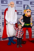 A child poses with Getafix and Asterix at the 'Asterix and Obelix 3D' Premiere during the 2012 Doha Tribeca Film Festival at o n November 23 2012 in...