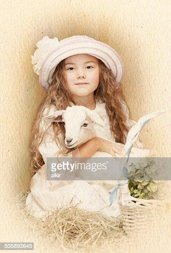 Enfant posant avec son animal de compagnie de chèvre : Photo
