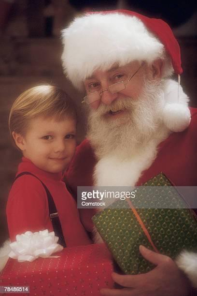 Child posing with Santa Claus