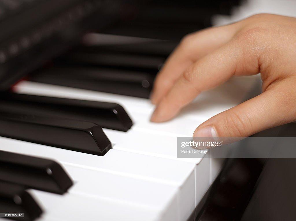 Child practicing piano : Stock Photo