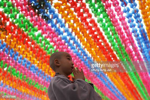 A child prays during the 'Children Becoming Buddhist Monks' ceremony forthcoming buddha's birthday at a Chogye temple on May 11 2015 in Seoul South...