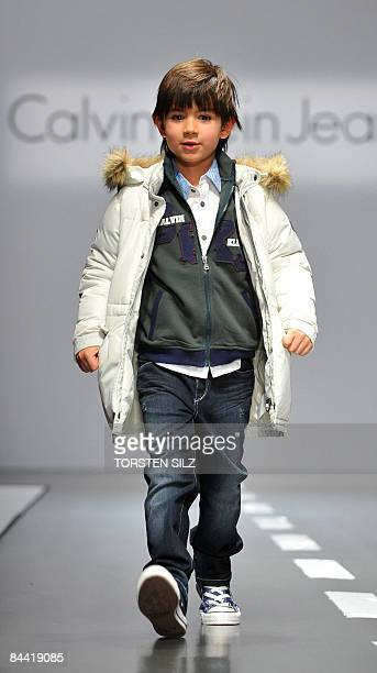 A child presents fashion from the fall/winter 2009/2010 collection of the label Calvin Klein on January 23 2009 in Florence during the 'Pitti...