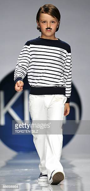 A child presents fashion of the label 'Calvin Klein' on June 26 2009 in Florence Italy during the 'Pitti Immagine Bimbo' fashion fair The 69th...
