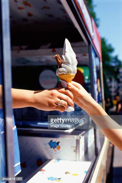 Child reaching for an ice cream