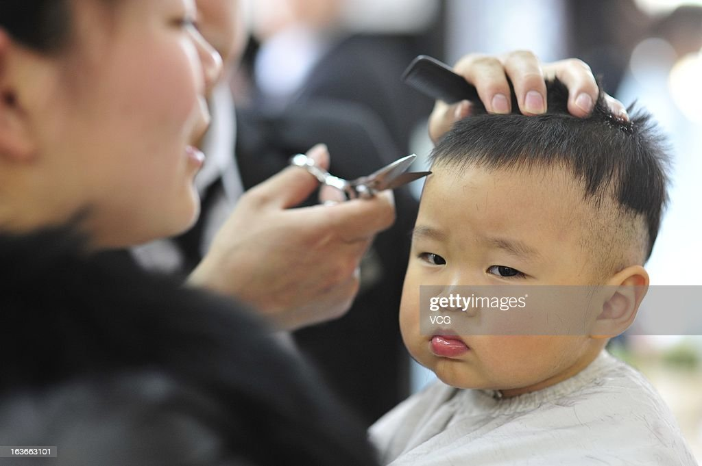A child reacts as he gets a haircut at a barbershop during the traditional festival known as Dragon Head Raising Day on March 13, 2013 in Taiyuan, China. Dragon Head Raising Day is celebrated on the second day of the second lunar month in China during which the traditional custom of getting a haircut is believed to bring good luck.