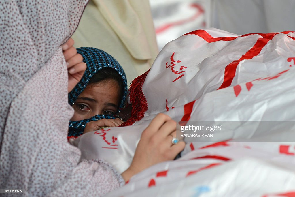 A child reacts as Pakistani Shiite Muslims gather around the coffin of a bomb attack victim on the third day of protests following Saturday's bombing in Quetta on February 19, 2013, against the bombing targeted Shiite Muslims. Pakistani forces on Tuesday killed four men and arrested seven others accused of killing Shiite Muslims, including an alleged mastermind of a bomb attack that killed 89 people, officials said. AFP PHOTO/Banaras KHAN