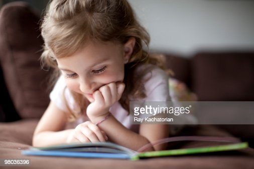 Child reading : Stock Photo