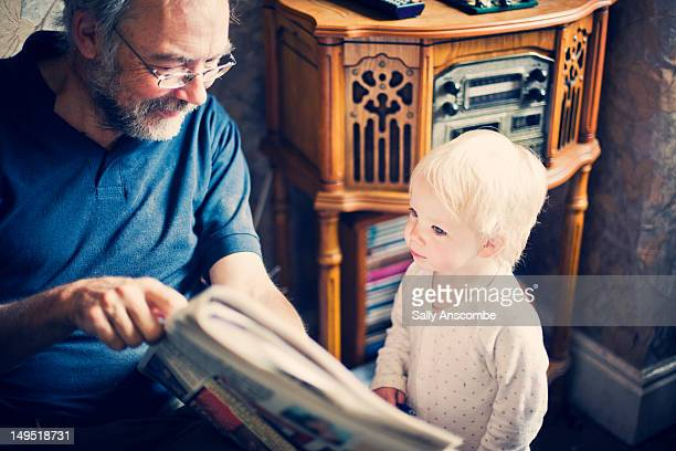 Child reading the newspaper