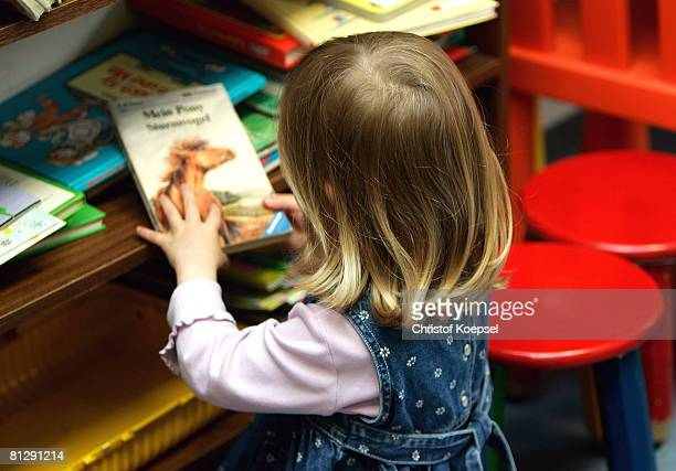 A child reads a book at the Wuppertal Tafel on May 30 2008 in WuppertalBarmen Germany Unicef United Nation's Children's Fund reports an alarming...