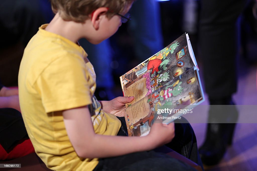A child reads at the McDonald's Reading Event at McDonalds Kurfuersten Damm on May 8, 2013 in Berlin, Germany.