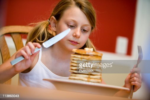 Child ready to eat huge stack of pancakes : Stock Photo
